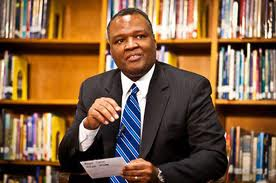 Executive Rushern Baker speaking in a PGCPS library